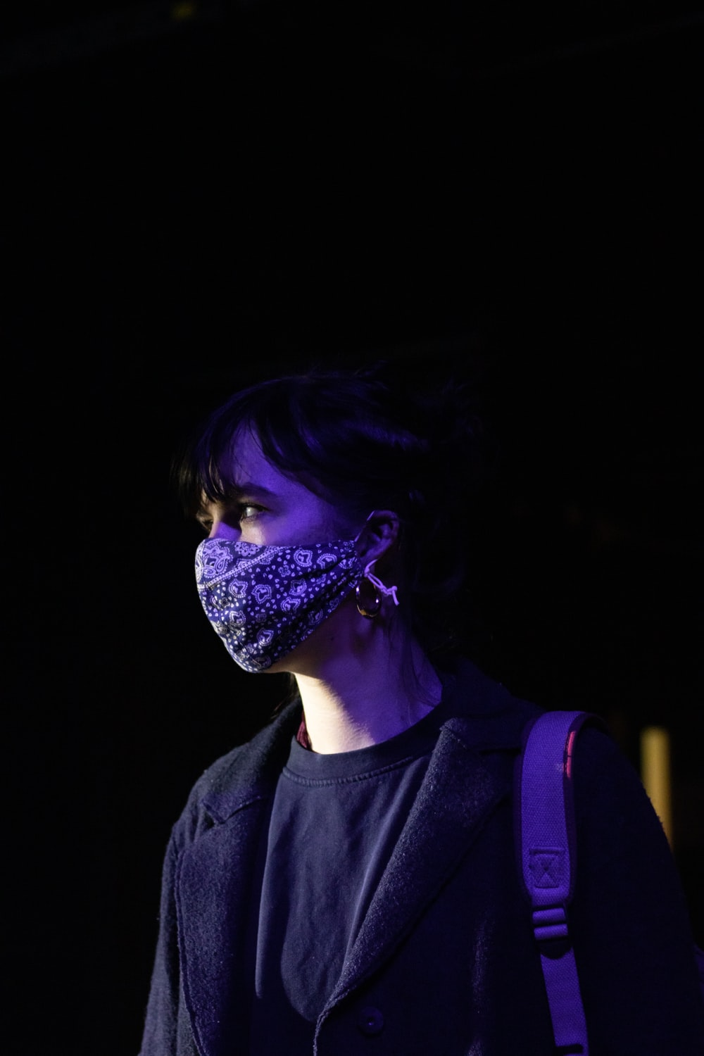 woman in black crew neck shirt with purple and blue face paint