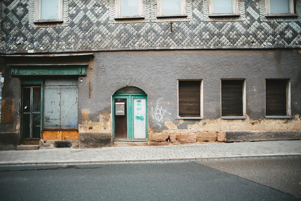 brown brick building with blue wooden door