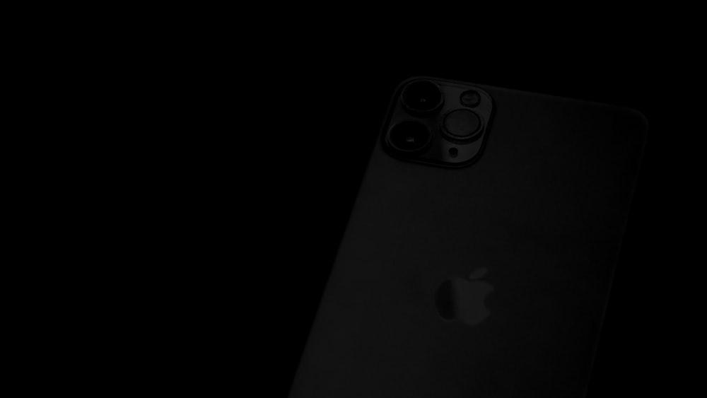 black iphone 7 on black surface