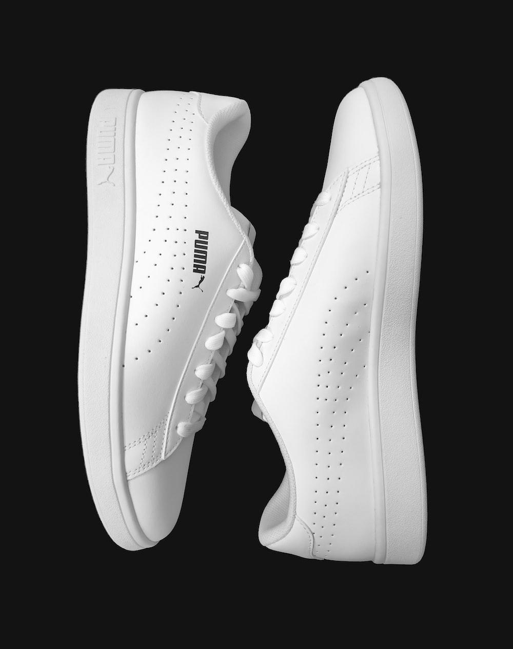 white nike athletic shoes on white background
