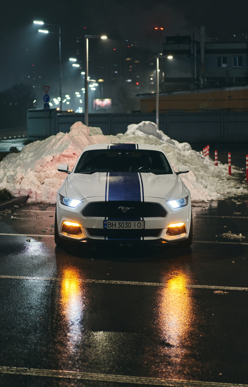 white bmw m 3 on road during night time