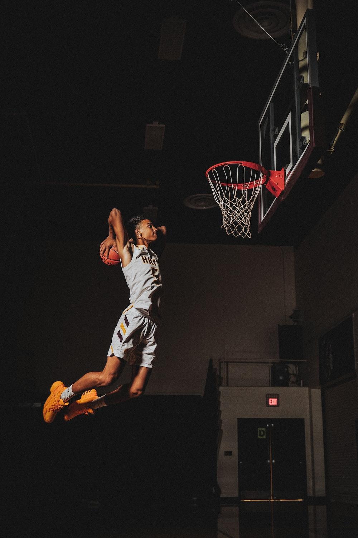 2 boys playing basketball on basketball court