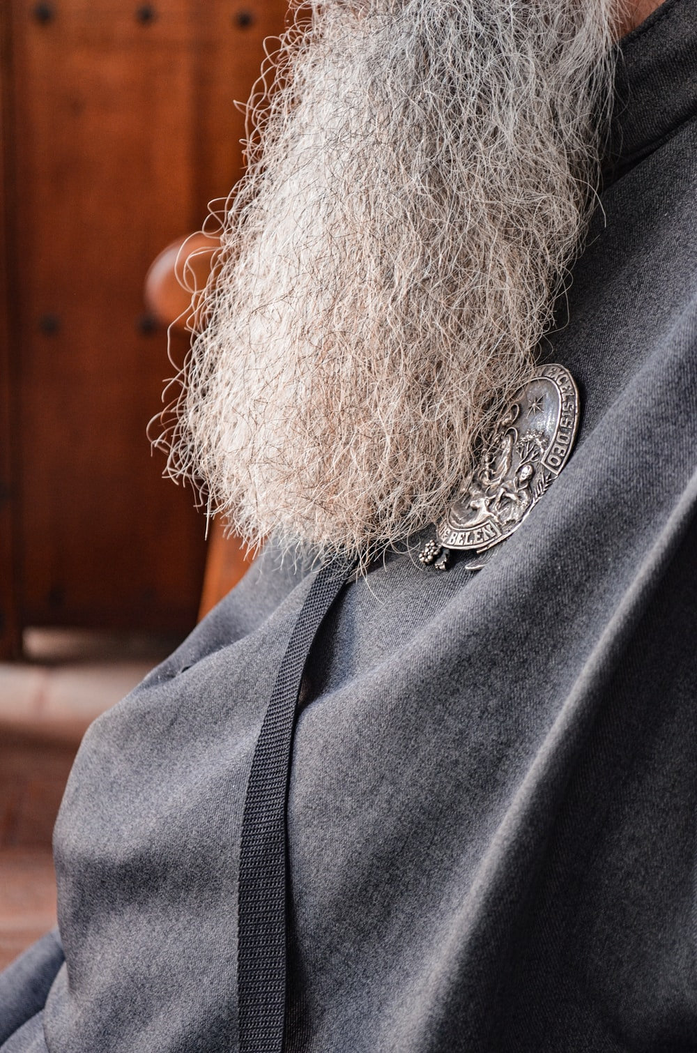 person wearing silver and black necklace