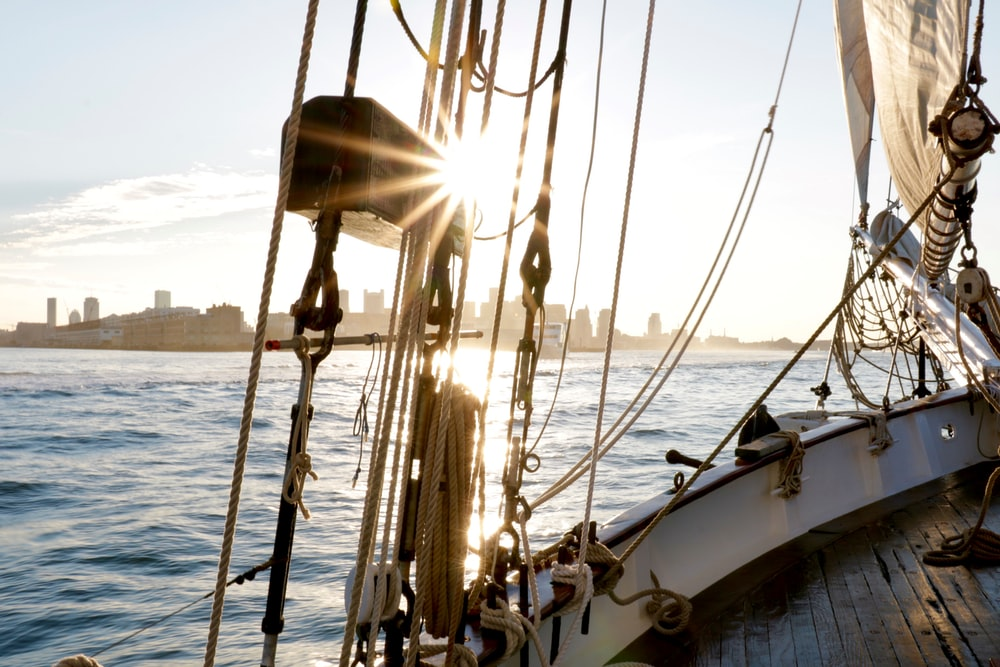 white and brown sail boat on sea during daytime