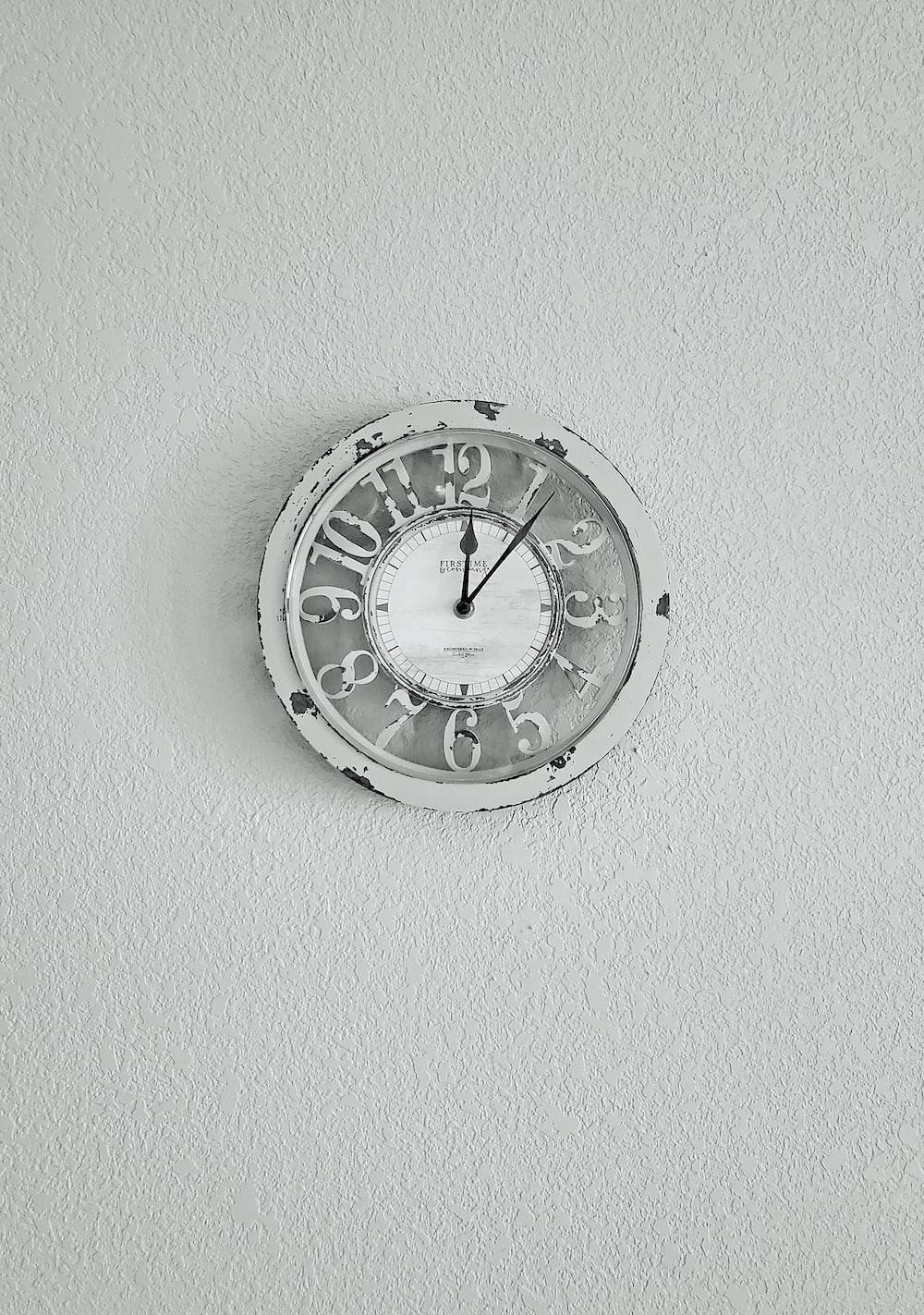 silver round analog wall clock