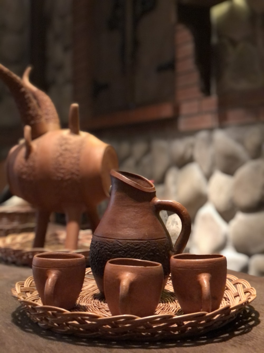 brown ceramic pitcher on table