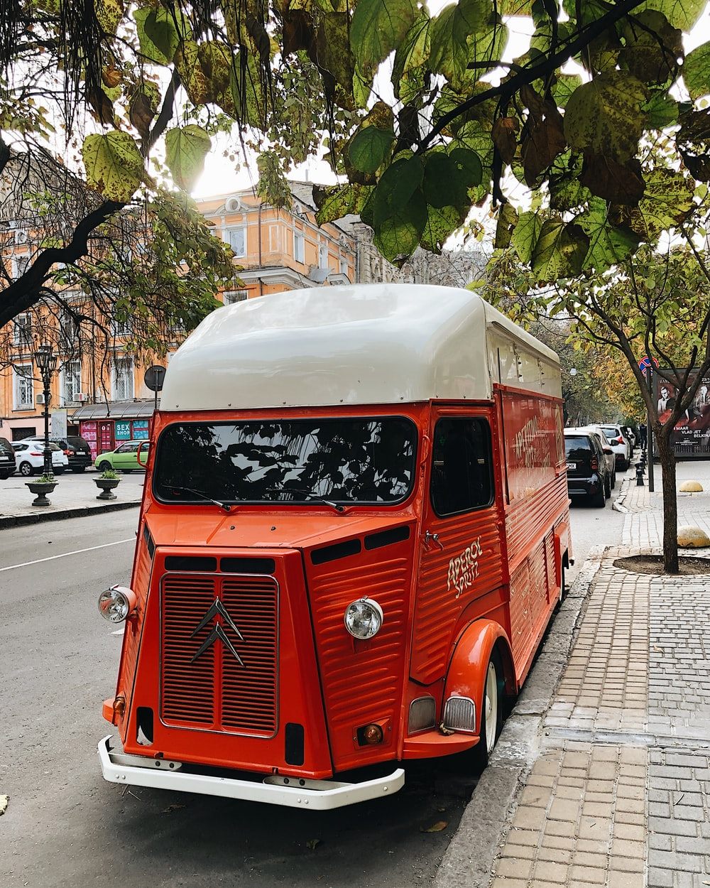 red and white van on road during daytime