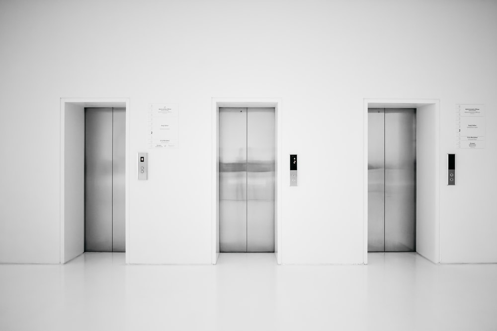 white wooden door in white room