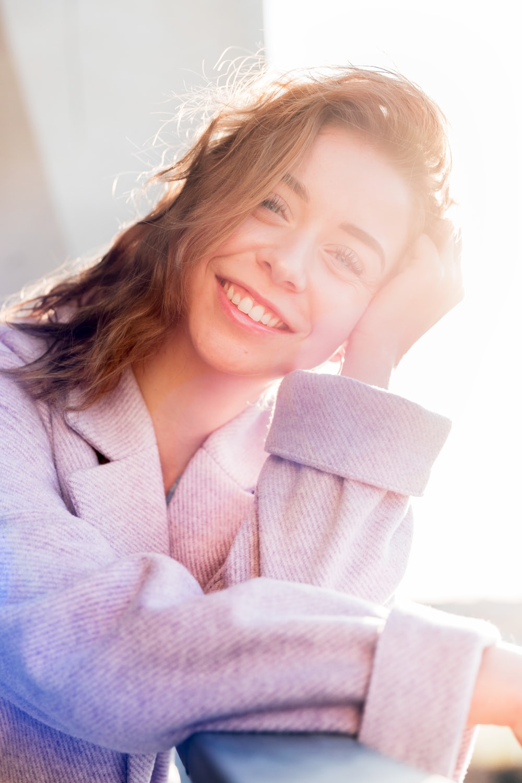 smiling girl in pink dress shirt