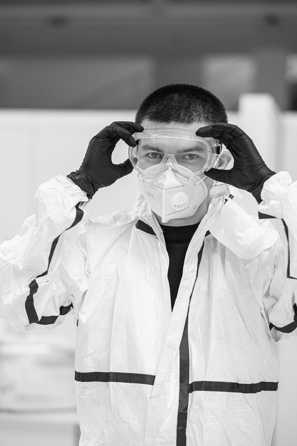 grayscale photo of woman in white robe wearing face mask