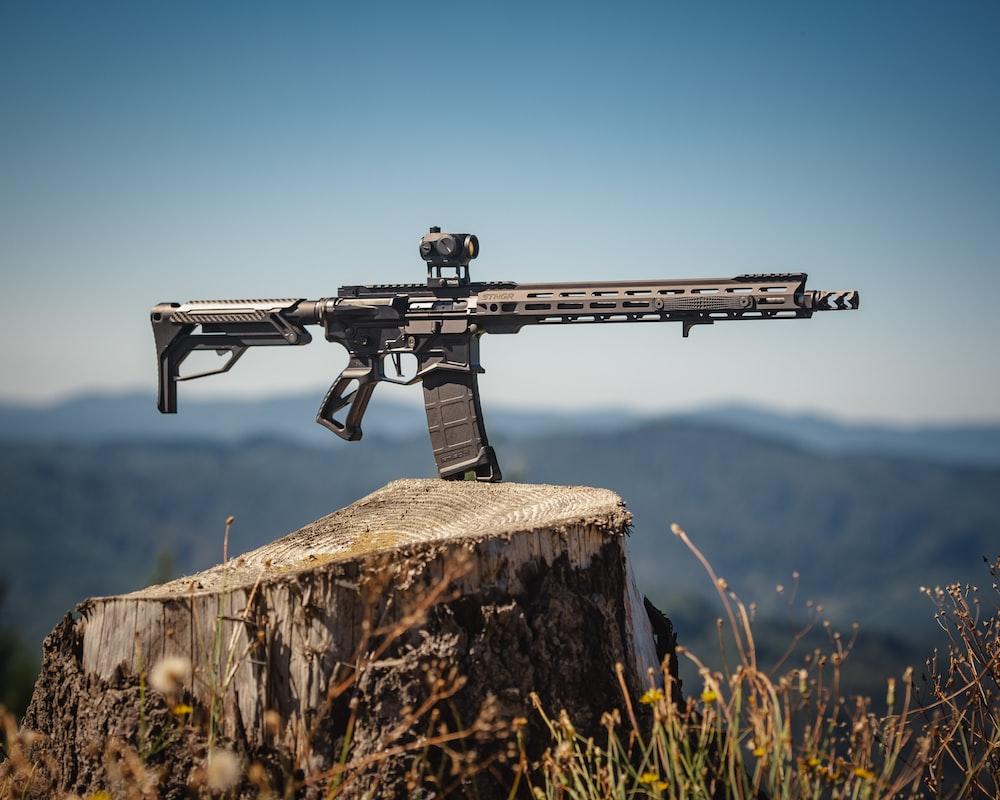 black rifle on brown rock