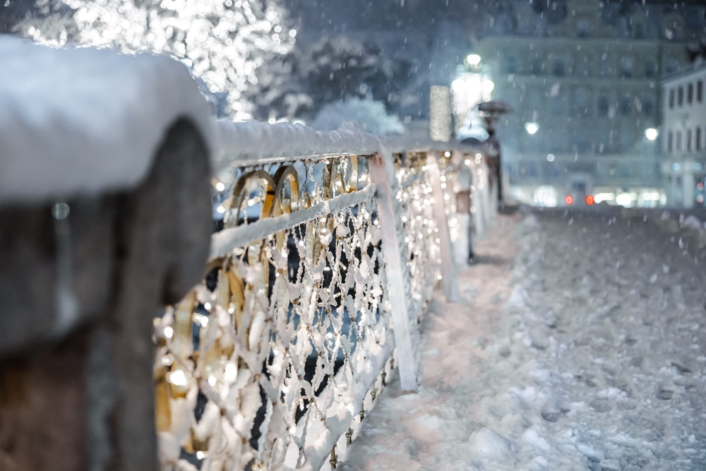 snow covered fence during daytime