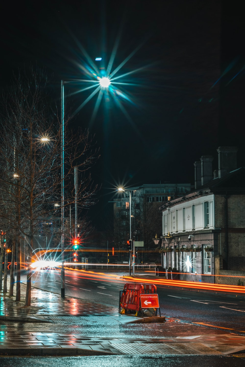 cars on road near building during night time