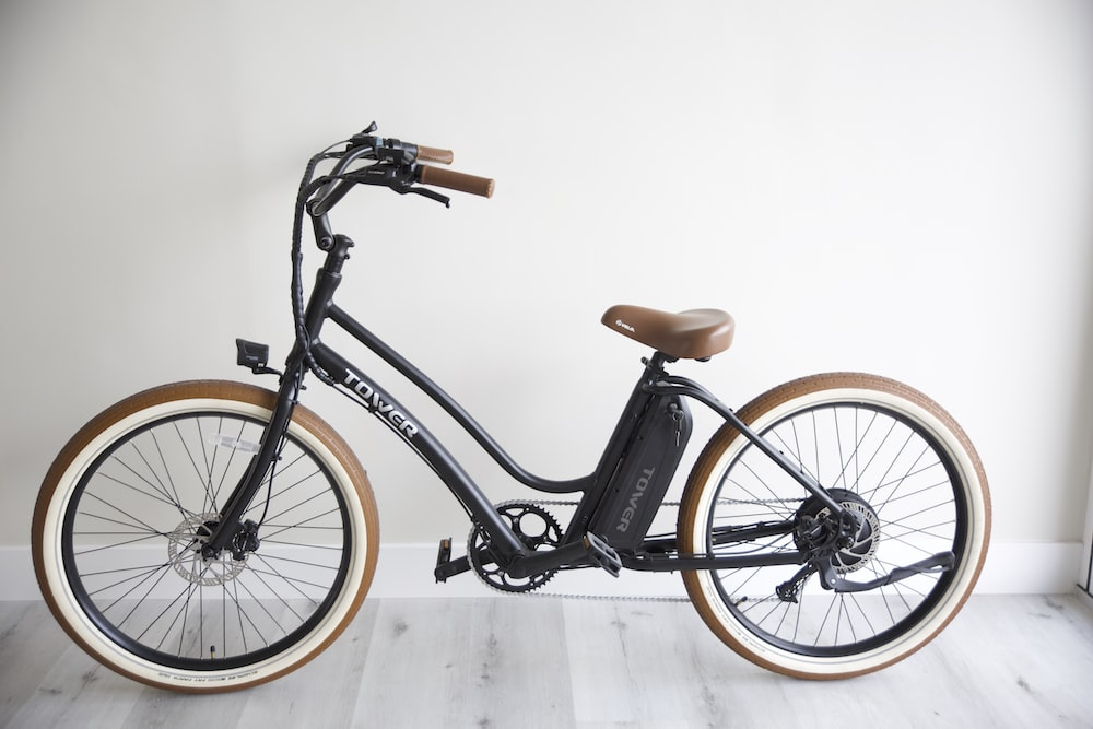 black and brown bicycle on white floor