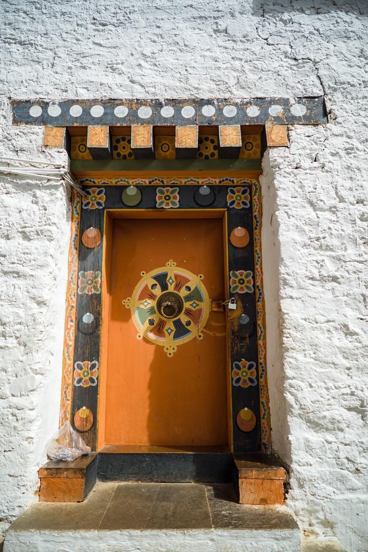 brown wooden door with gold door knob
