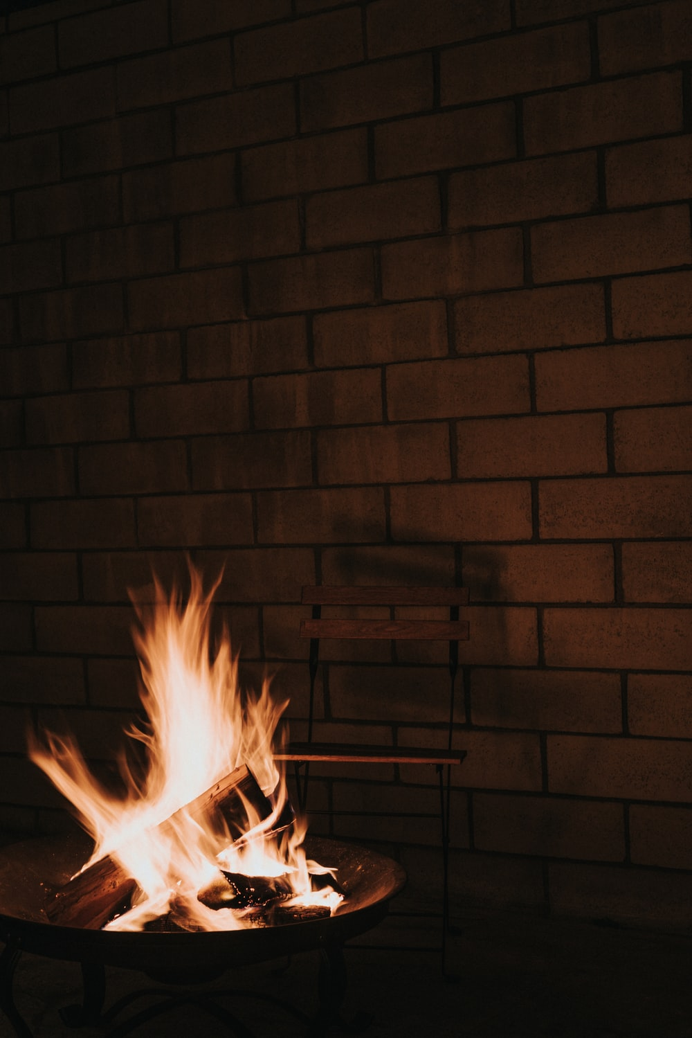 fire in brown brick wall