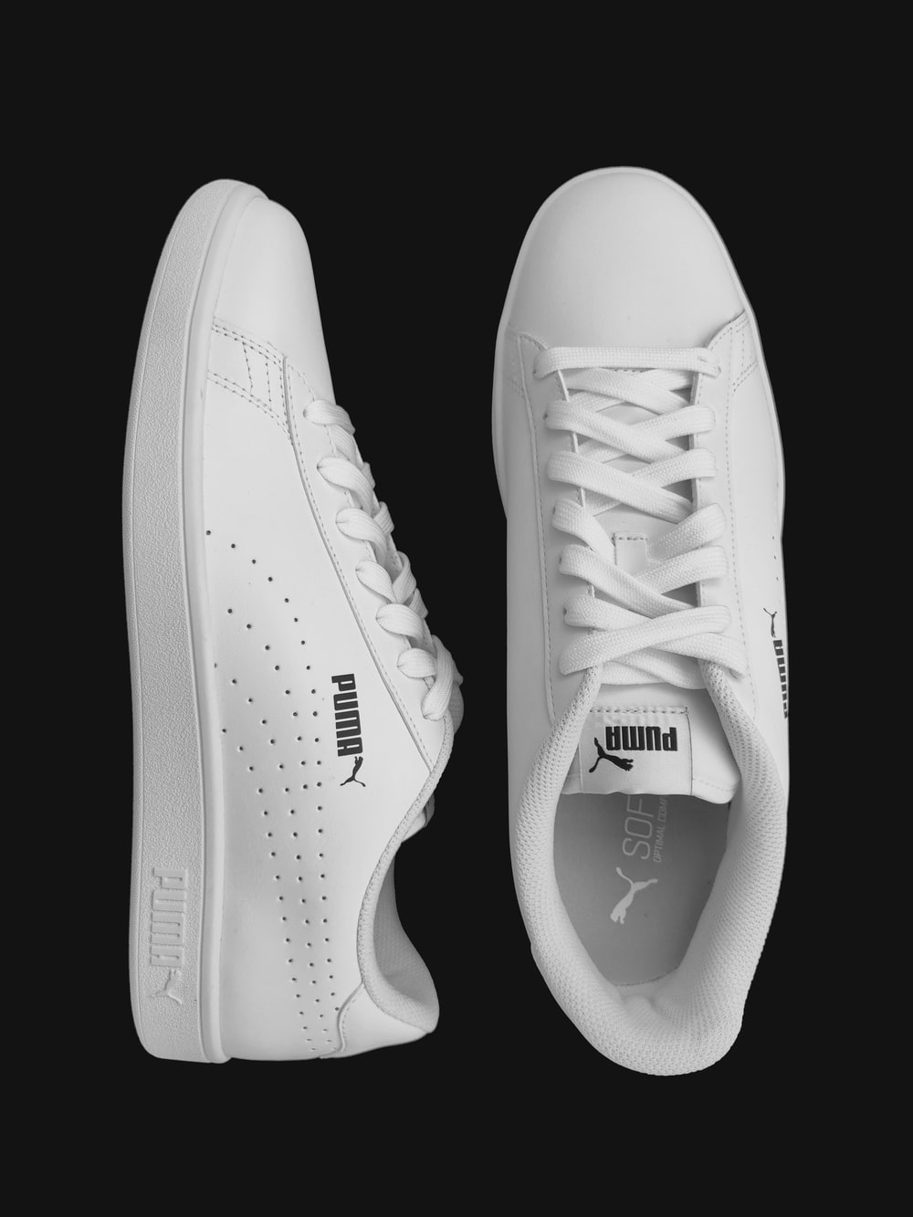 white and black nike athletic shoes