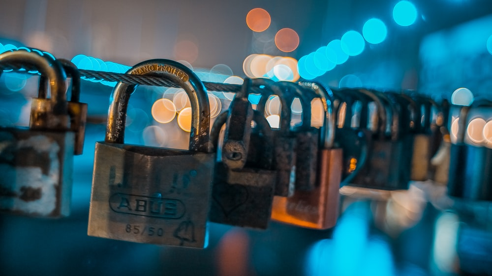 padlock on chain during night time