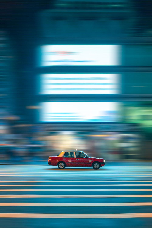 red sedan on road during daytime