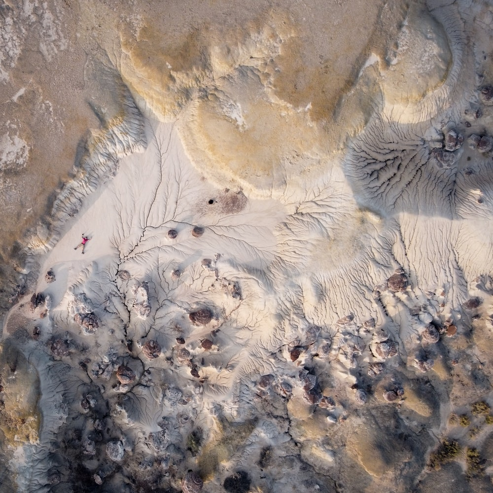 birds eye view of white and brown sand