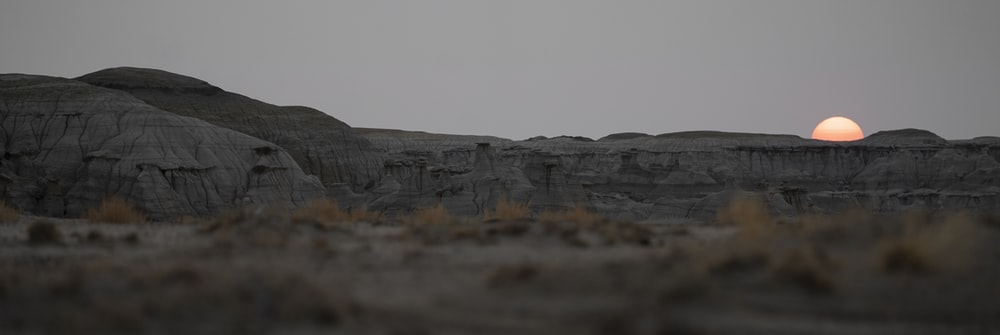gray rock formation under white sky during daytime