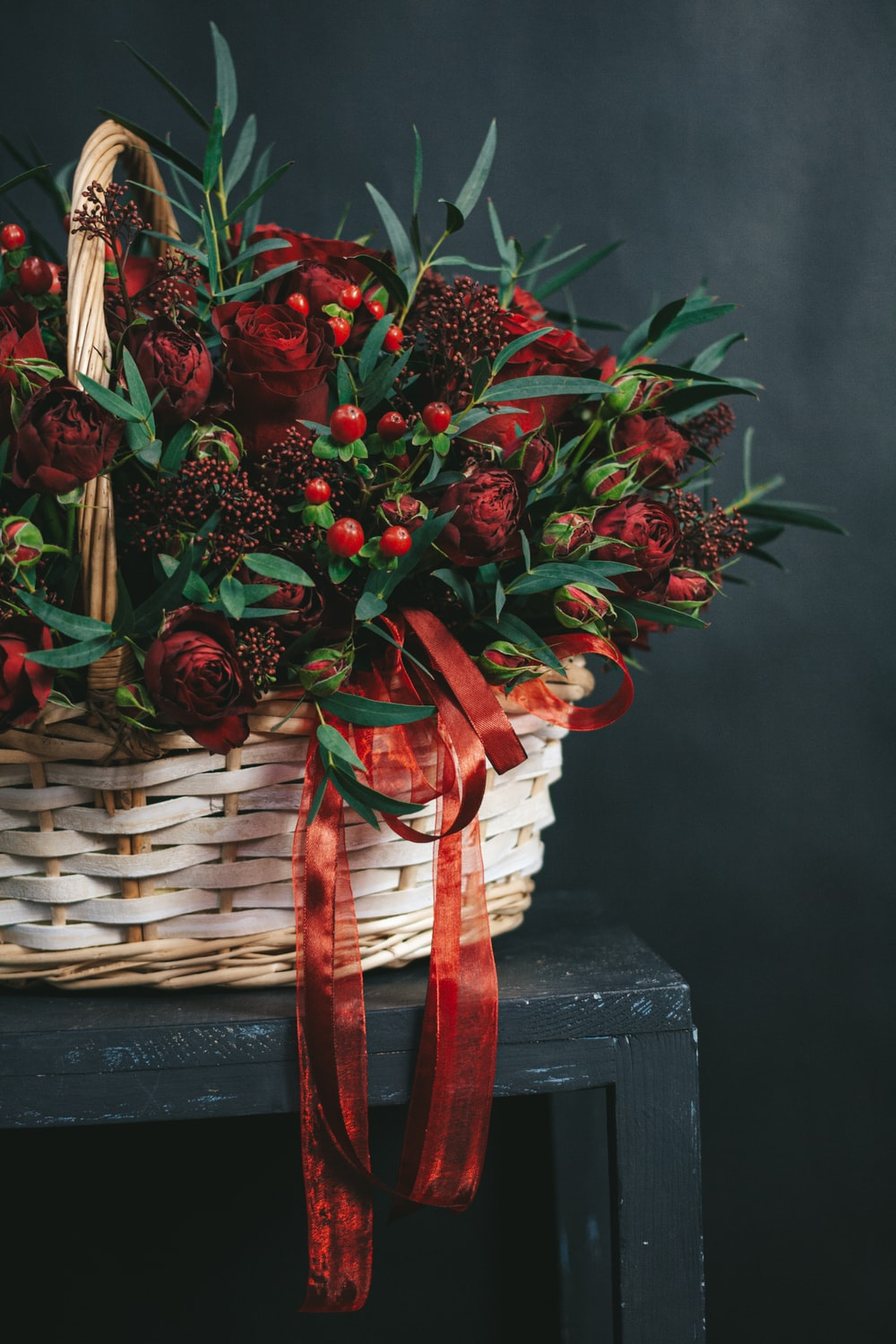 red flowers on brown woven basket