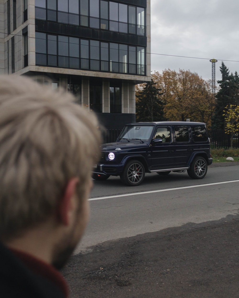 black suv parked near building during daytime