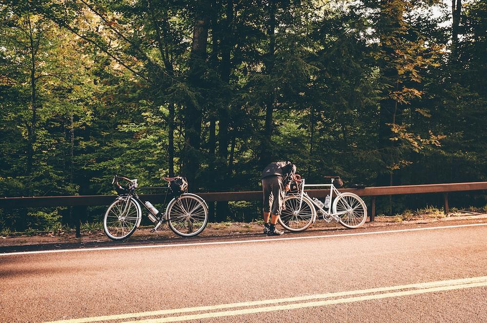 black bicycle on road during daytime