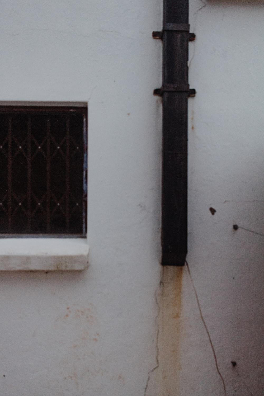 black metal window frame on white wall