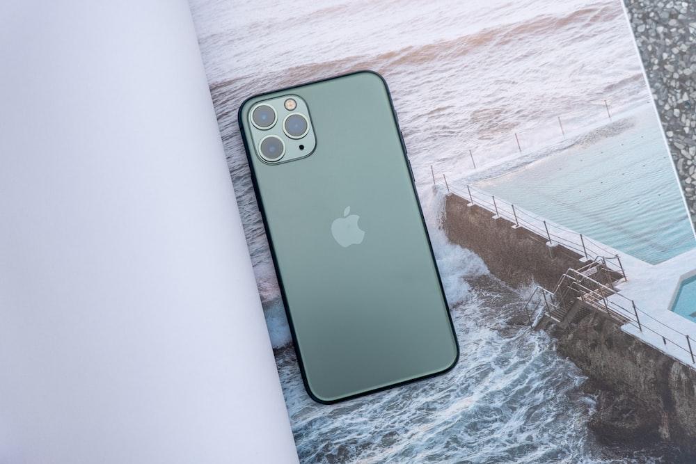 black iphone 7 plus on white textile