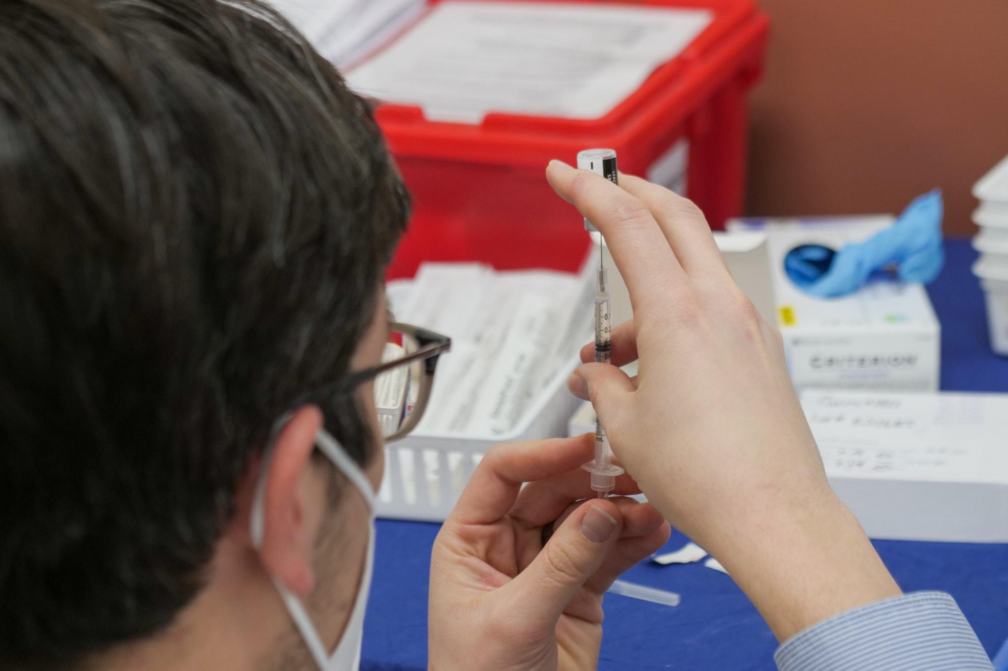 Pharmacist preps Covid-19 vaccine