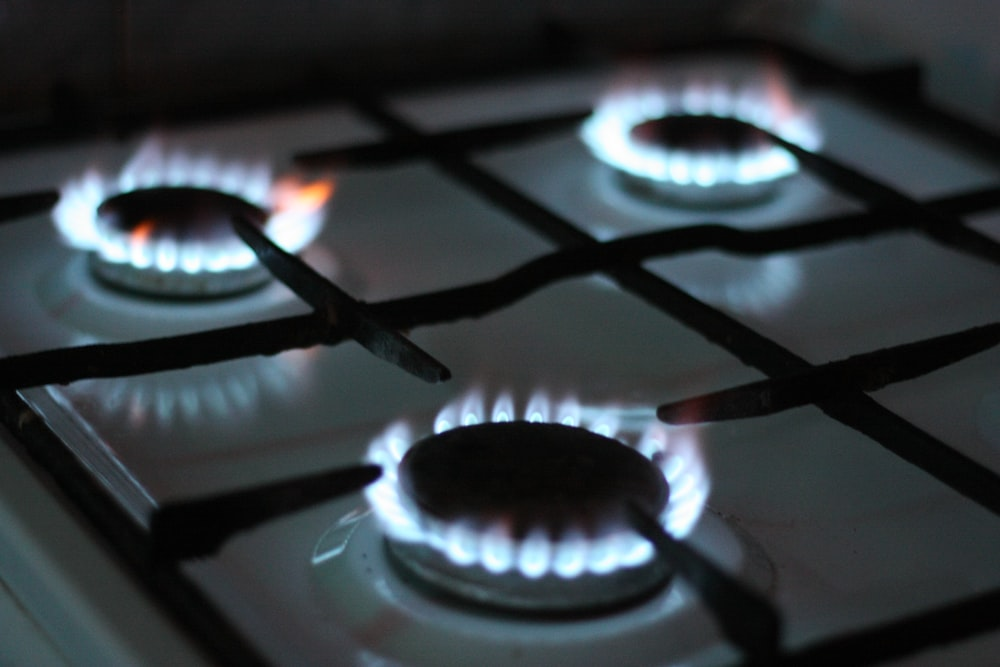 black gas stove with white and black gas stove