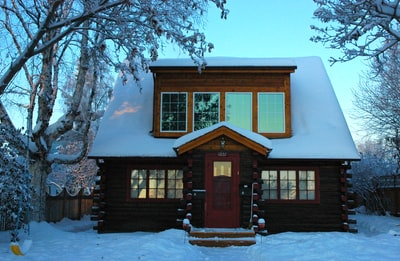 brown wooden house covered with snow during daytime log cabin zoom background