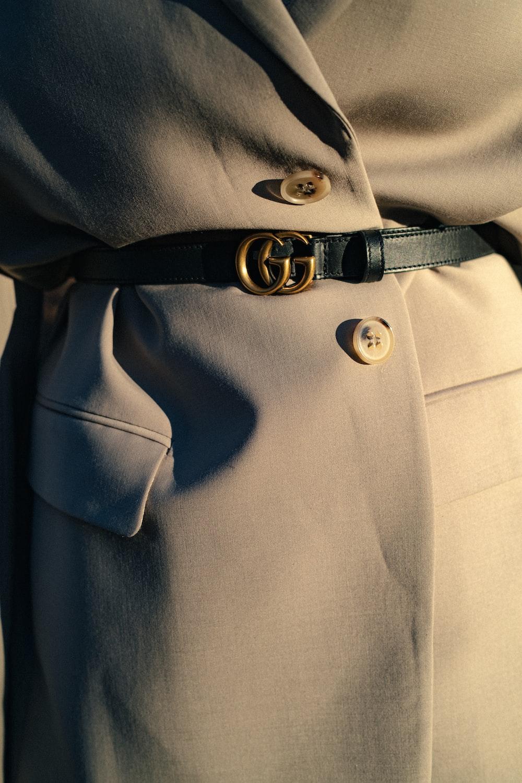 black leather belt on gray textile