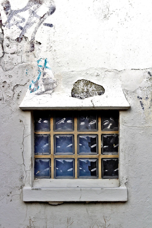 blue wooden framed glass window