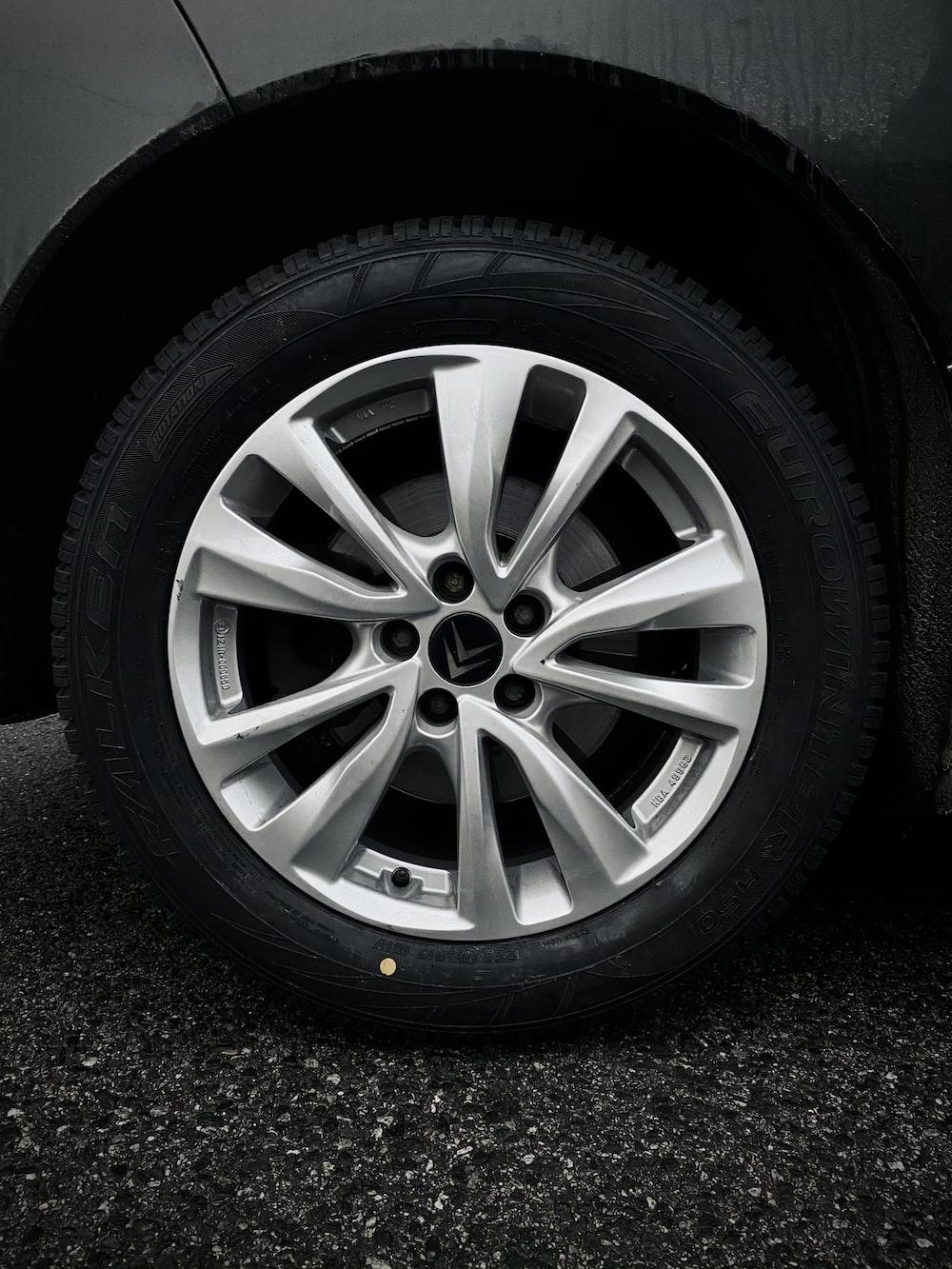 silver 5 spoke wheel with tire