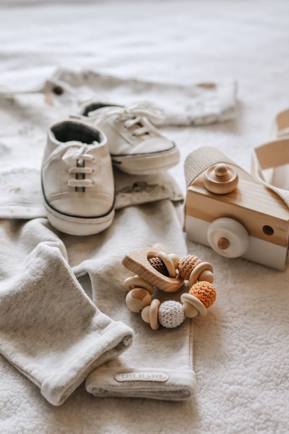 brown wooden dog toy beside white textile