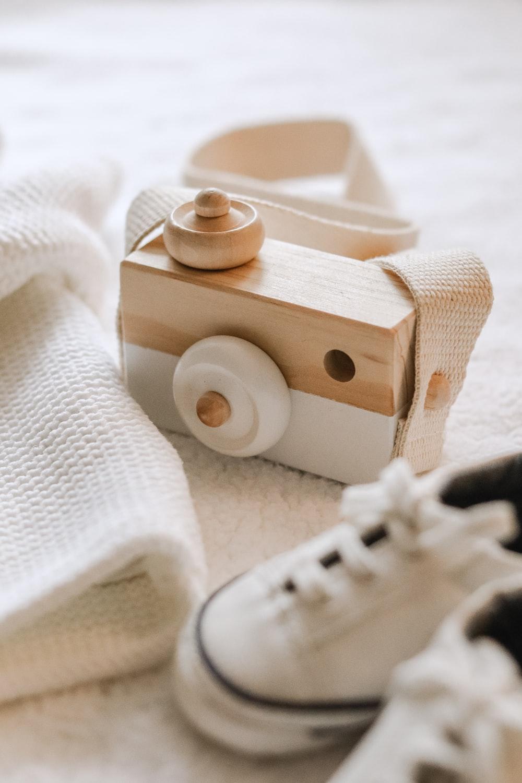 brown wooden toy on white textile