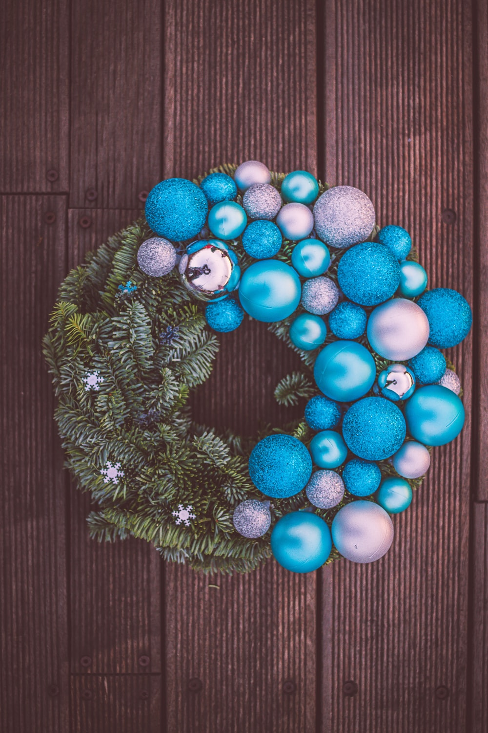 red and blue baubles on green pine tree