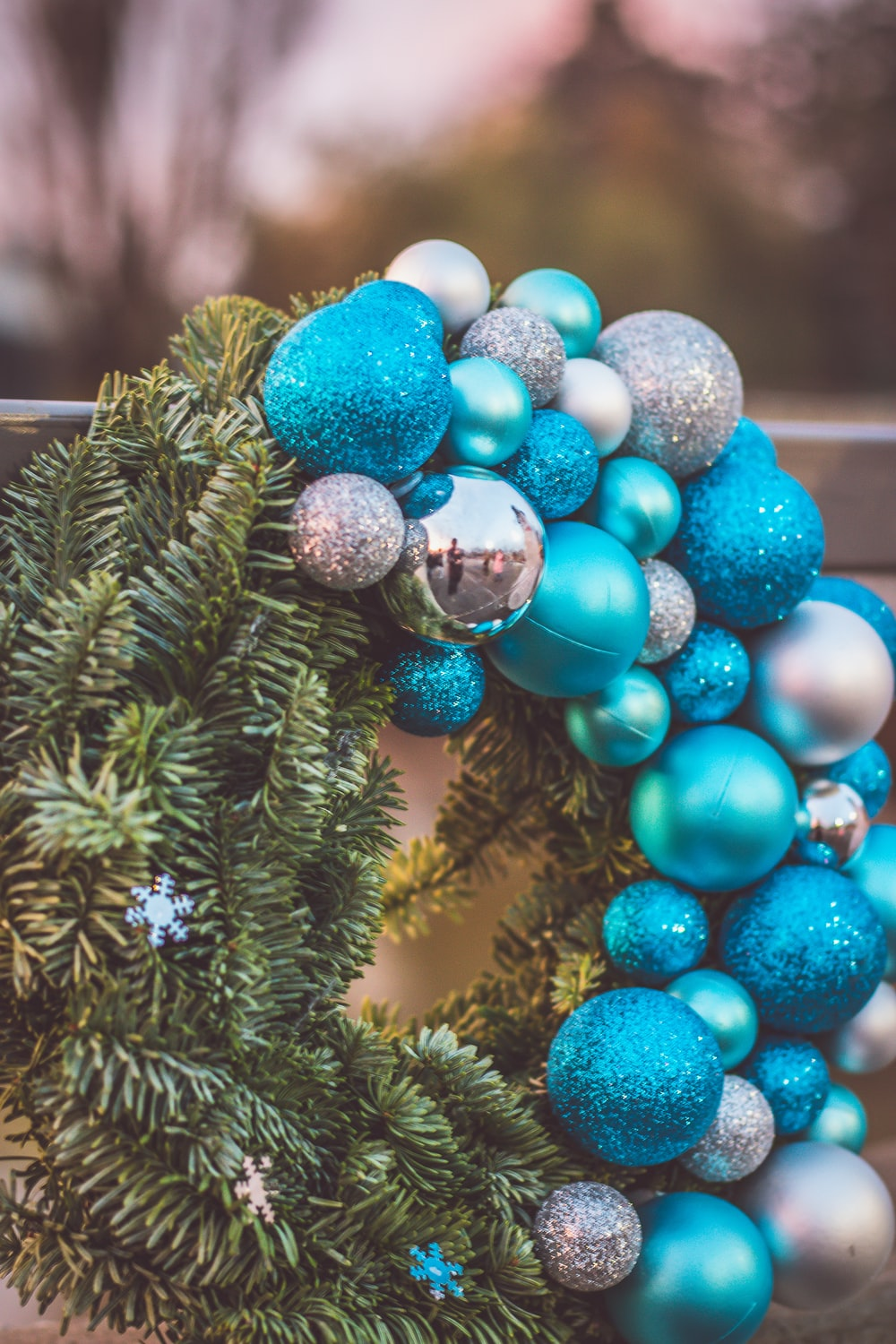 blue and silver baubles on green pine tree