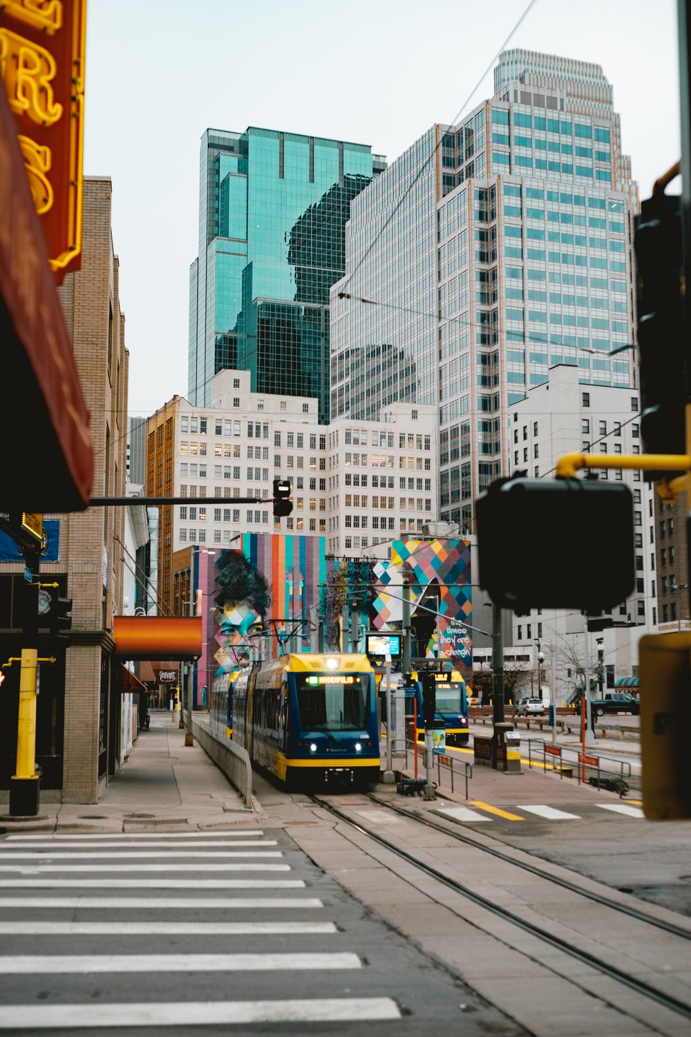 yellow and black tram on road during daytime