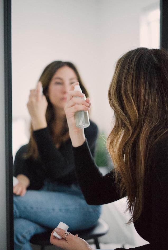 Women applying Toner from a Spray