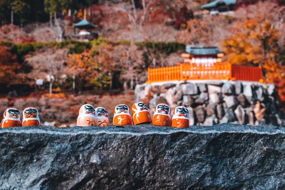 orange and white plastic bottles on gray concrete wall
