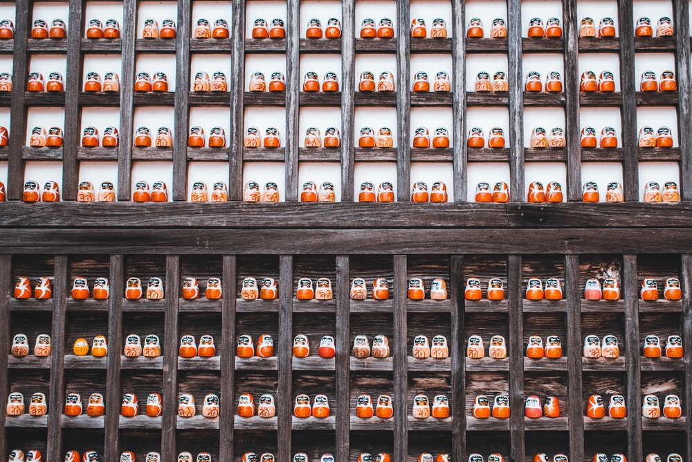 black wooden shelf with bottles