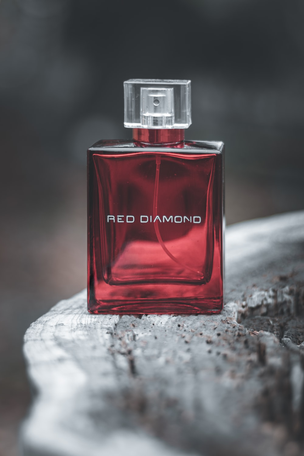 red and black perfume bottle
