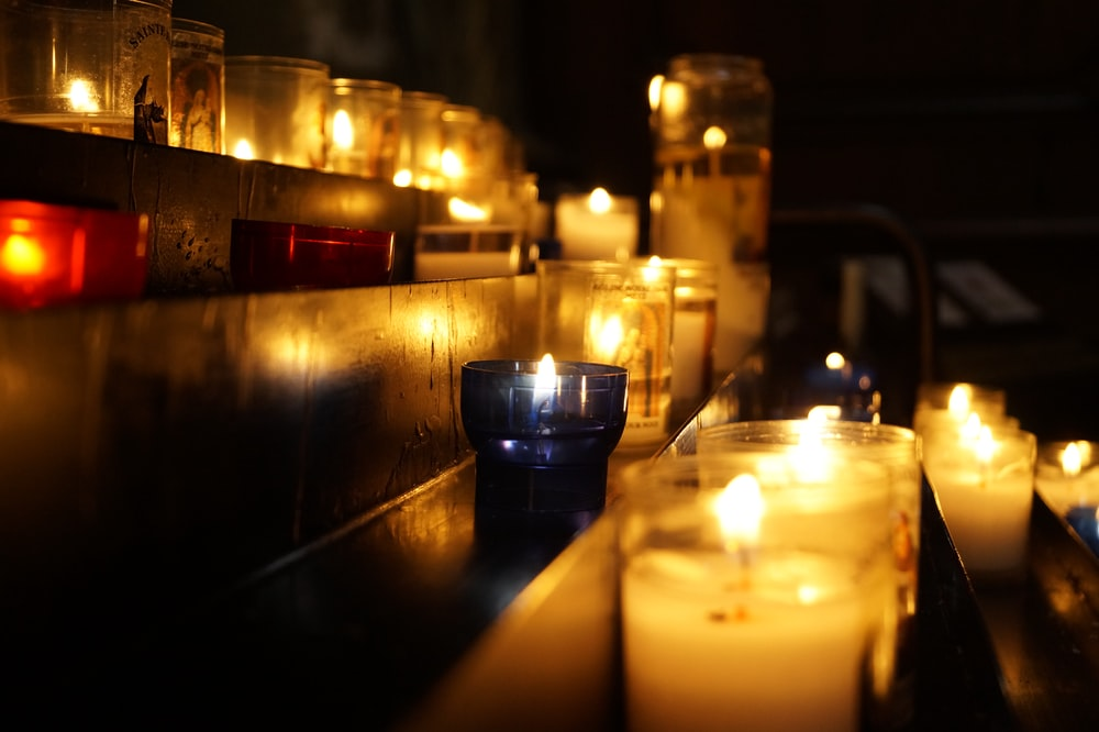 candles on brown wooden table