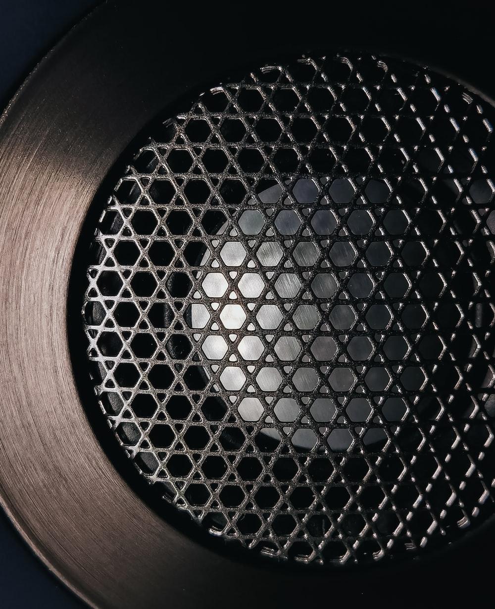 brown and black round speaker