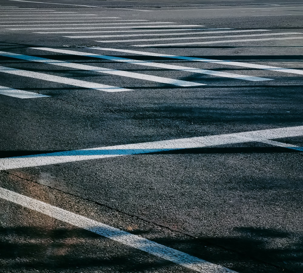 gray and white pedestrian lane