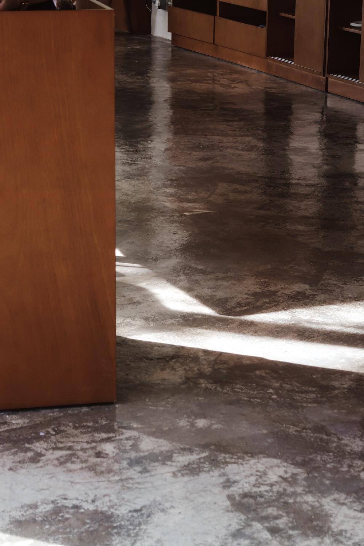brown wooden door near gray concrete floor