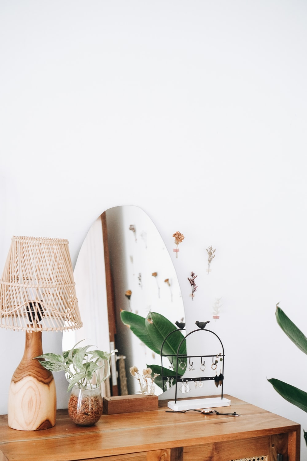 white and green flower beside brown table lamp